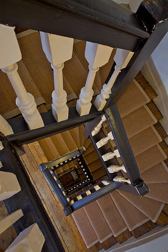 View of the open staircase at Dr Johnson's House, taken from the top floor towards the ground floor.